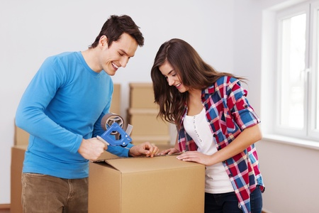 Loving couple packing boxes Stock Photo - 18880735