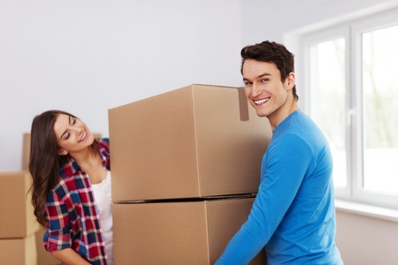 Young couple carrying boxes Stock Photo - 18880695