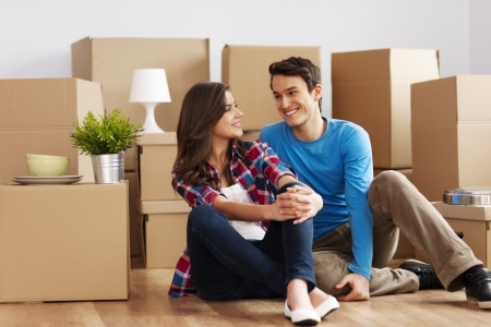 young man portrait: Couple moving in house Stock Photo