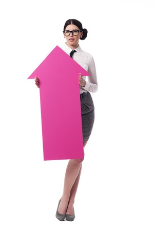 Beautiful businesswoman holding pink arrow sign  photo