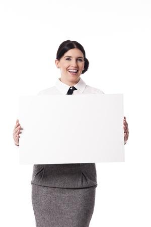 billboard posting: Businesswoman holding blank sign