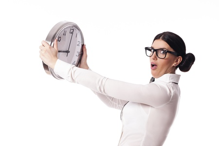 Shocked woman holding a office clock photo