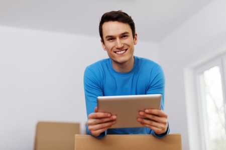 Happy man organize relocation in his new apartment  Stock Photo - 19098801