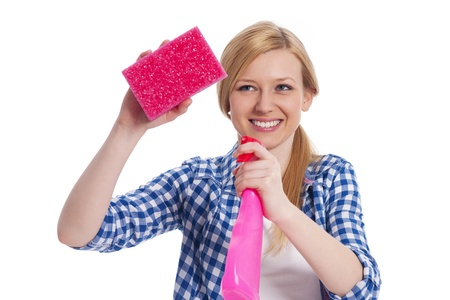 Young blonde female holding a cleaning equipment photo