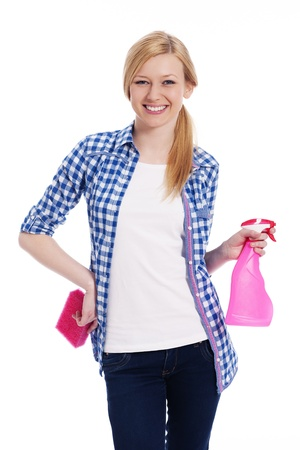 Blonde female cleaner holding a sponge and spray photo