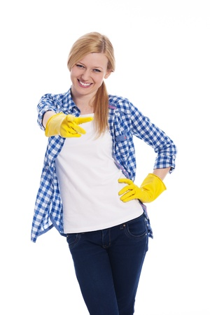woman pointing up: Female cleaner pointing finger at camera