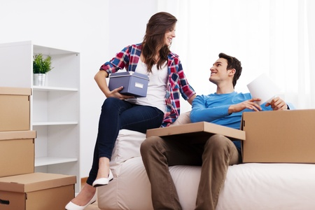 Loving couple unpacking in their new home  photo