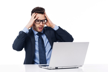 Shocked businessman looking at laptop Stock Photo - 19248661