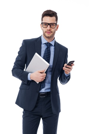 necktie: Handsome young businessman with a digital tablet and mobile phone Stock Photo