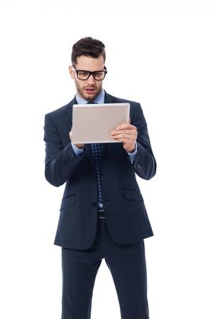 focused: Focused businessman using a digital tablet Stock Photo