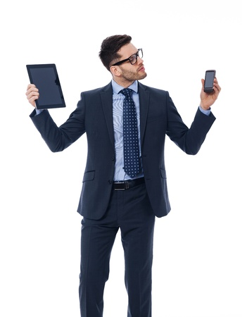 busy beard: Handsome businessman holding in his hands digital tablet and mobile phone Stock Photo