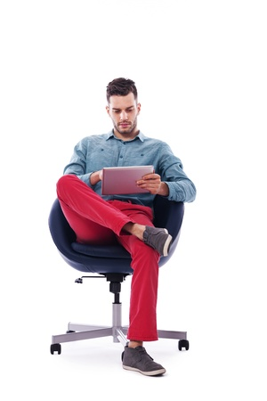 Trendy and young man using digital tablet photo