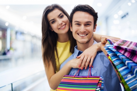 Loving couple in shopping mall Stock Photo