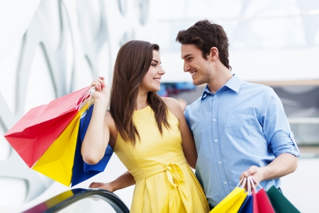 Conversing couple on shopping Stock Photo - 19428729