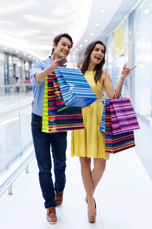 man shopping: Just look there  There is exactly what we were looking for  Stock Photo