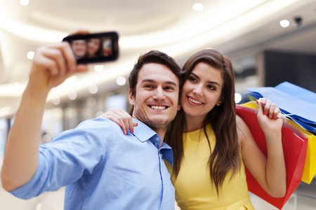 Happy couple taking a photo during a shopping  Stock Photo