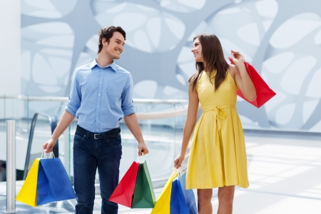 man carrying woman: Happy couple after successful shopping Stock Photo