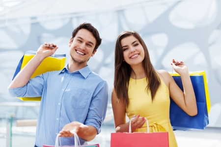 Happy young couple holding shopping bag  photo