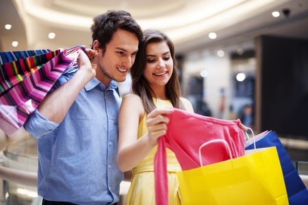 Happy couple looking at a new shirt Stock Photo - 19563258