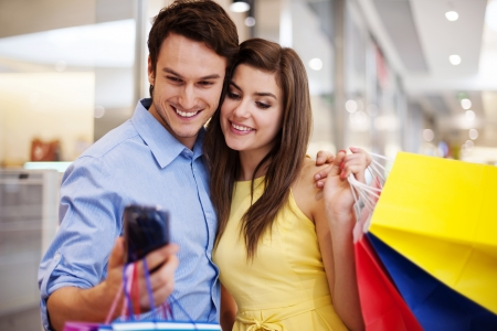 Bonding couple looking at mobile phone Stock Photo - 19563260