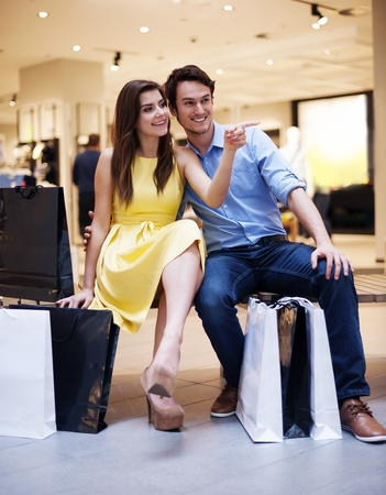 after shopping: Beautiful couple resting after luxury shopping