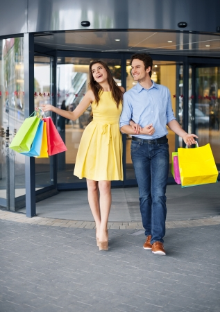 leaving: Happy couple after a successful shopping Stock Photo