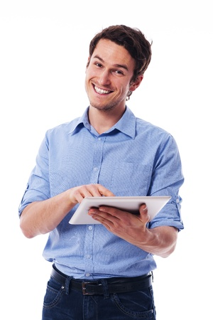 rolled up sleeves: Handsome man using a digital tablet