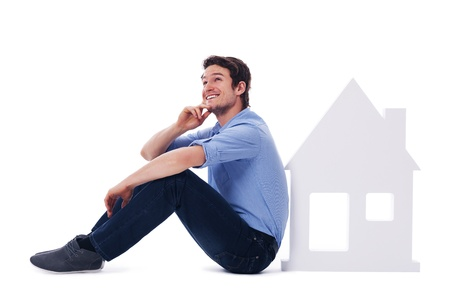 Dreaming man sitting next to a sign home Stock Photo - 19587871