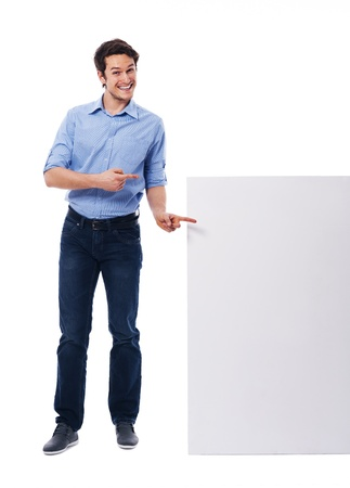 Happy man pointing on the white board photo