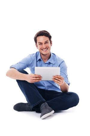 Sitting man using a digital tablet photo
