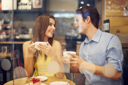 Two people in cafe enjoying the time spending with each other photo