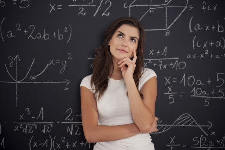 algebra: Female student thinking about mathematics problem