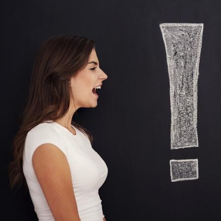woman open mouth: Loud screaming woman