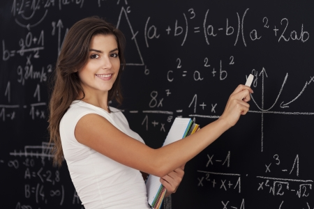 Happy woman solving mathematic problems photo