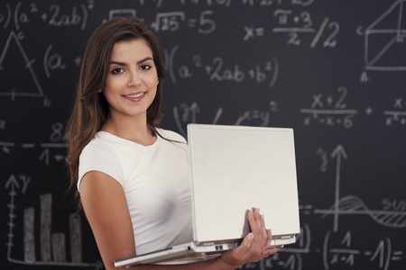 Female student with laptop in her hands  Stock Photo - 19750995