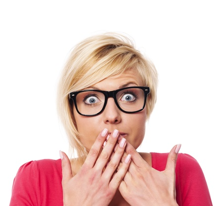 hands covering face: Surprised woman covering with hands her mouth  Stock Photo