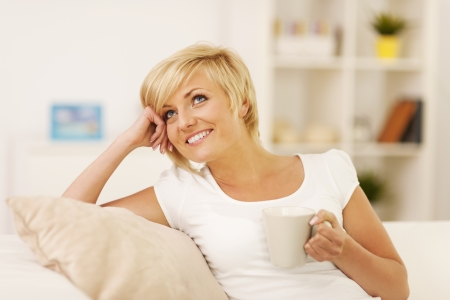 Resting with coffee on couch Stock Photo - 19846032