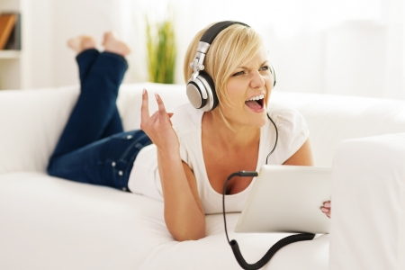 Woman listen to rock music at home   photo