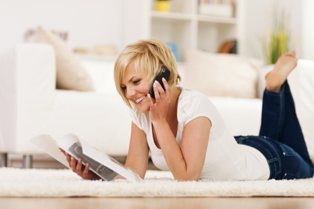 Happy woman ordering something from catalog photo