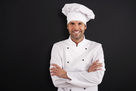 chefs whites: Portrait of smiling chef in uniform  Stock Photo
