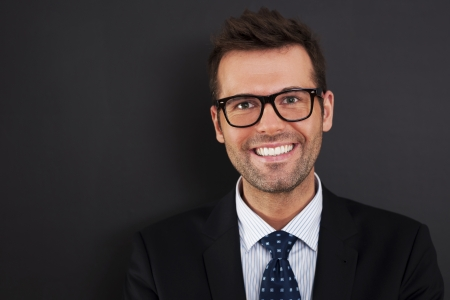 a close up: Portrait of handsome businessman wearing glasses   Stock Photo