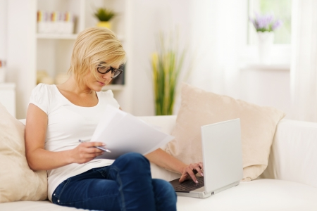 Beautiful woman working at home photo