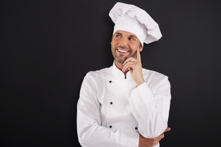 chefs whites: Smiling chef looking on the side  Stock Photo
