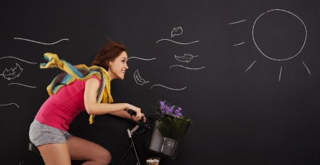 Happy woman on a bicycle photo