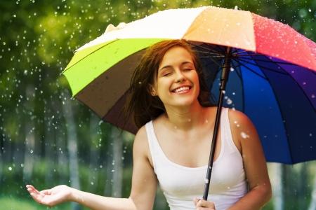woman: Beautiful woman enjoying summer rain