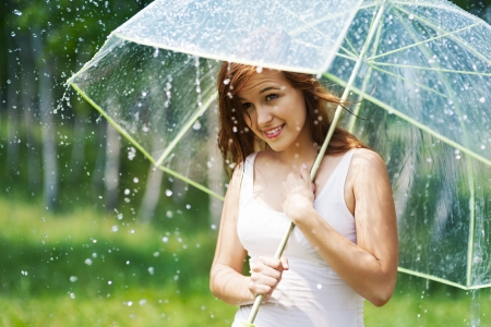 Beautiful woman with umbrella during the rain  