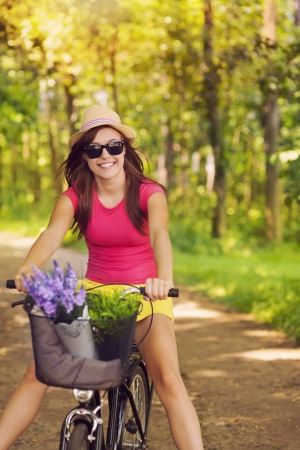 Beautiful woman have fun during cycling  photo