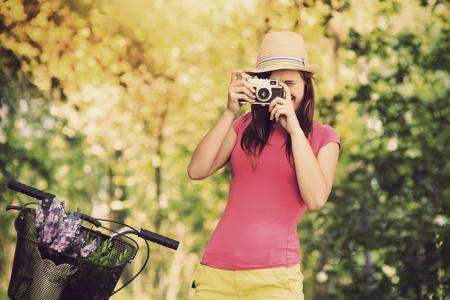 Retro photographer using old camera  photo