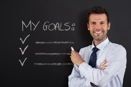 businessman standing: Businessman is ready to writing his goals