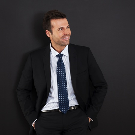 Portrait of handsome and smiling businessman  photo